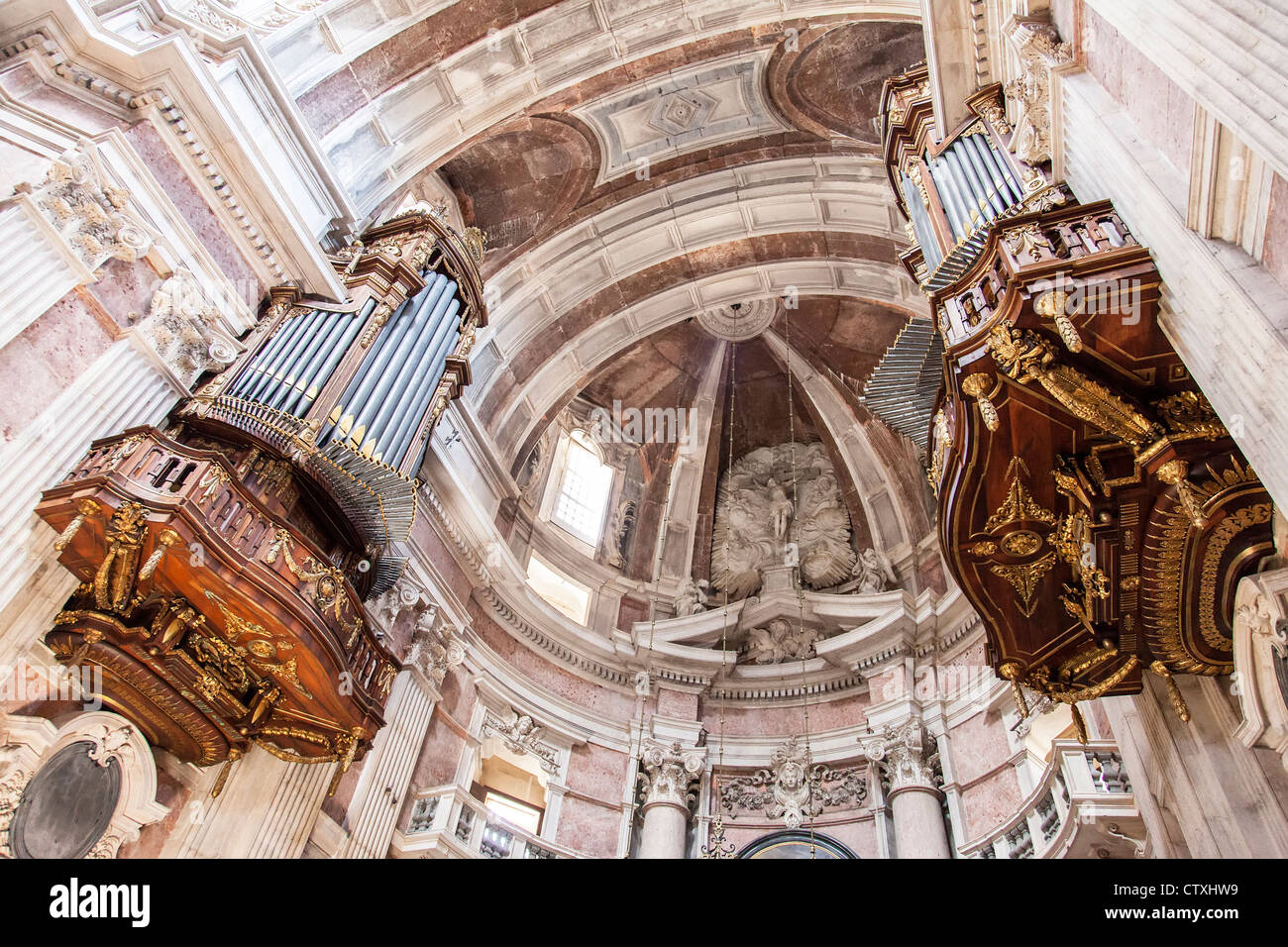 Two of the six organs (main altar area) of the Mafra National Palace and Convent in Portugal. Baroque architecture. - Stock Image