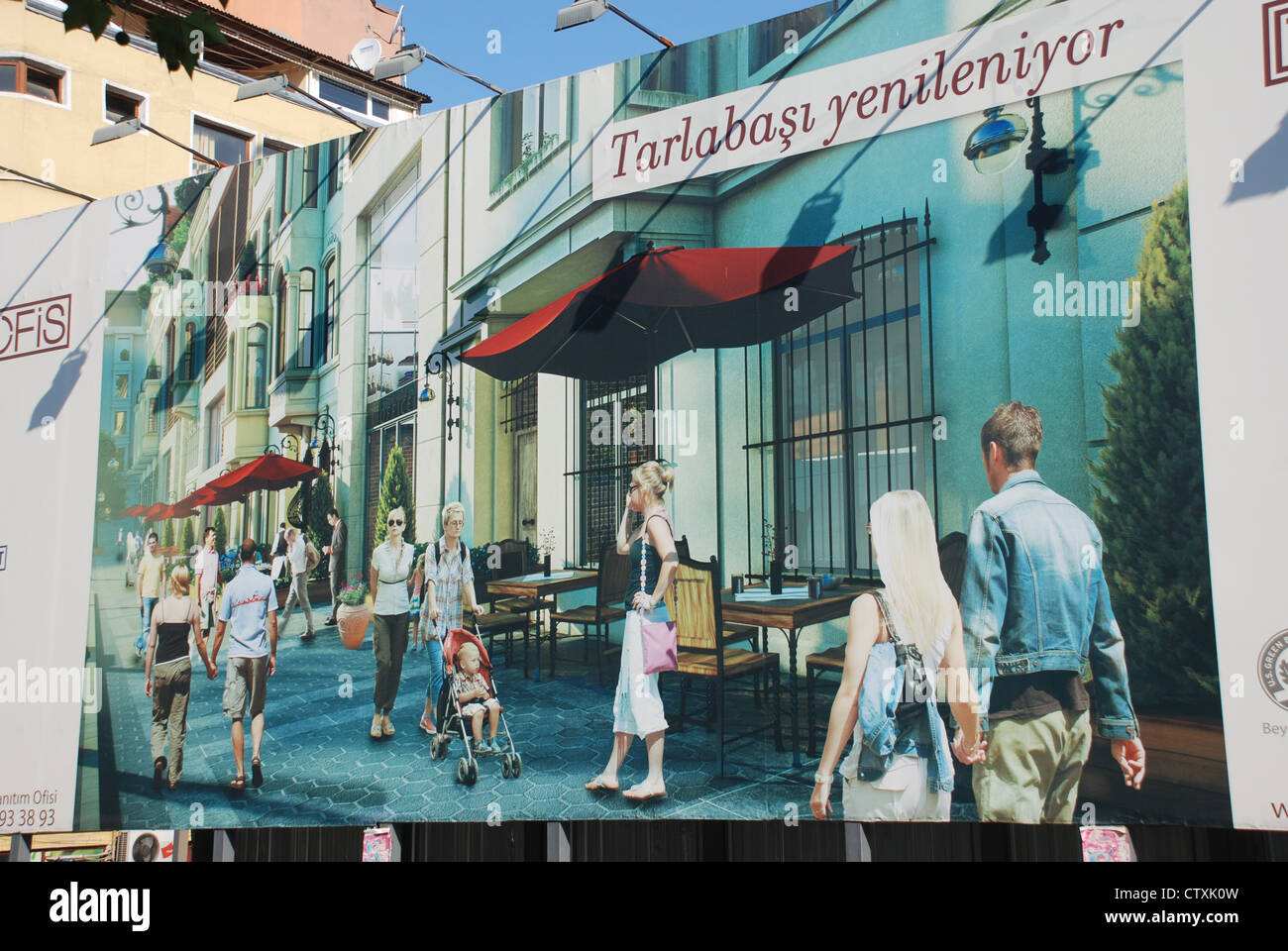 Giant posters on the edge of the soon-to-be gentrified Tarlabasi district of Istanbul show new residents as suspiciously - Stock Image