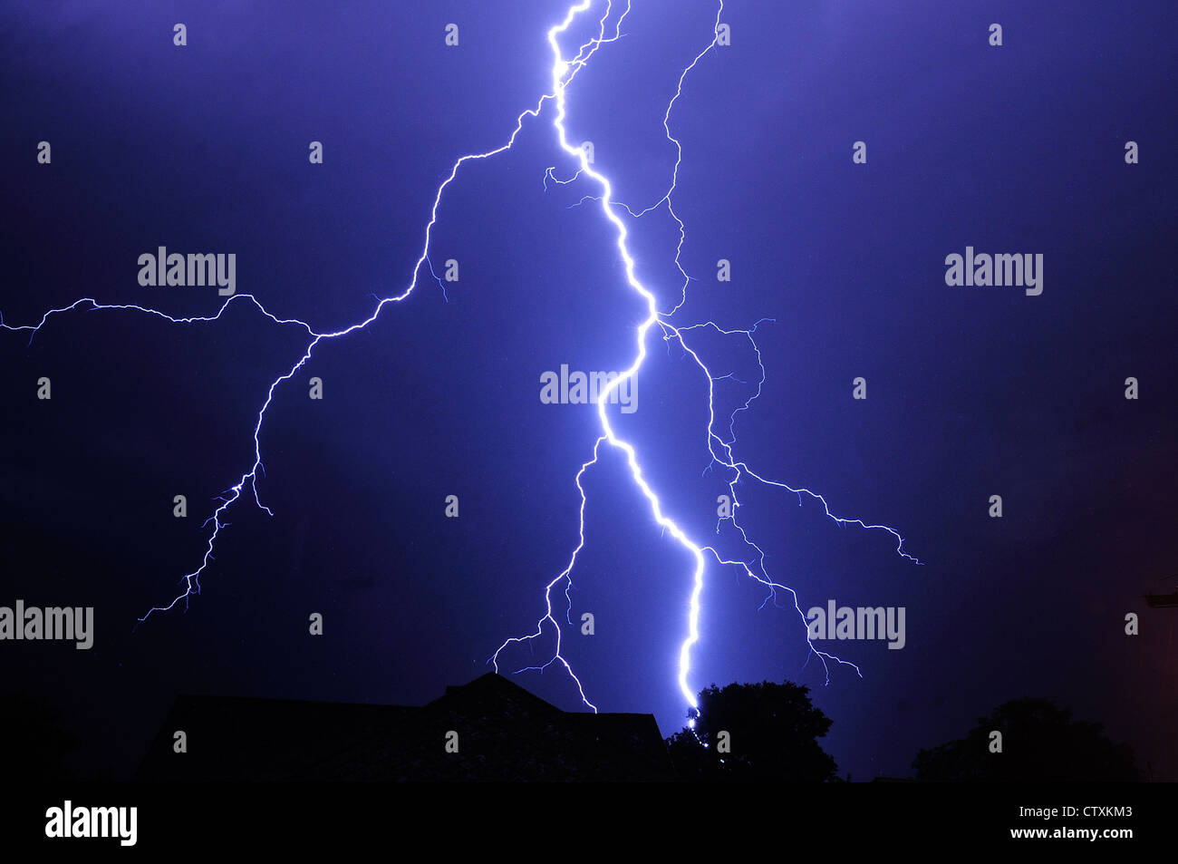 Night shot with big thunderstorm at the starry sky. - Stock Image