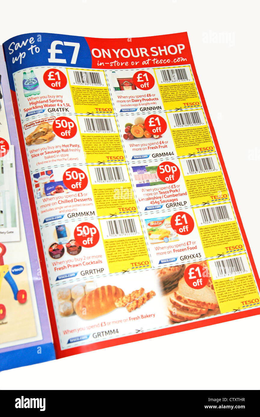 Tesco Money off coupons making savings to the weekly shop helping those who have money worries & issues - Stock Image