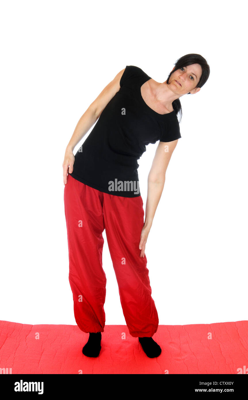 Mid adult woman cares for her fitness - Stock Image