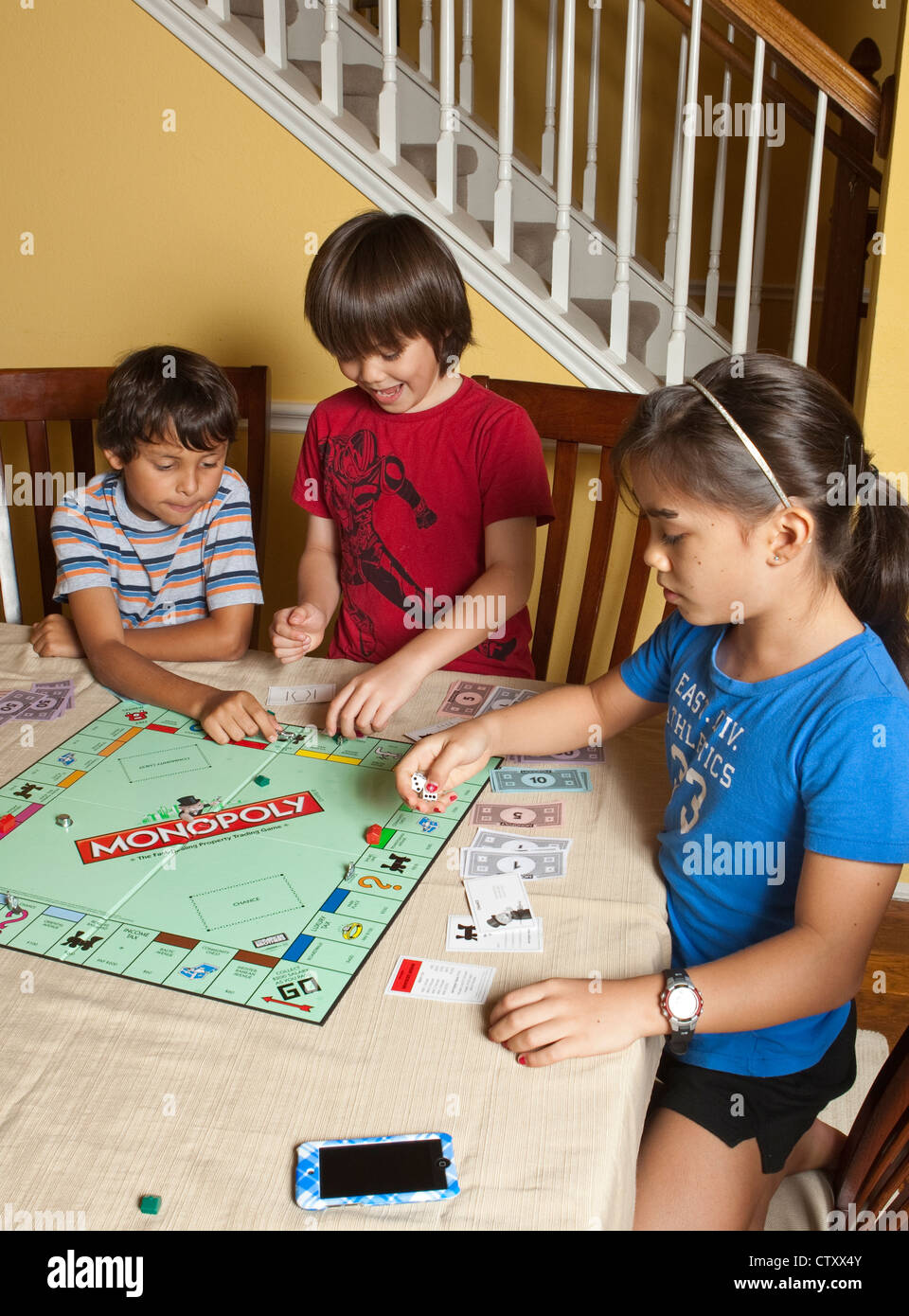 Multi-ethnic group of friends Hispanic and Asian play ...