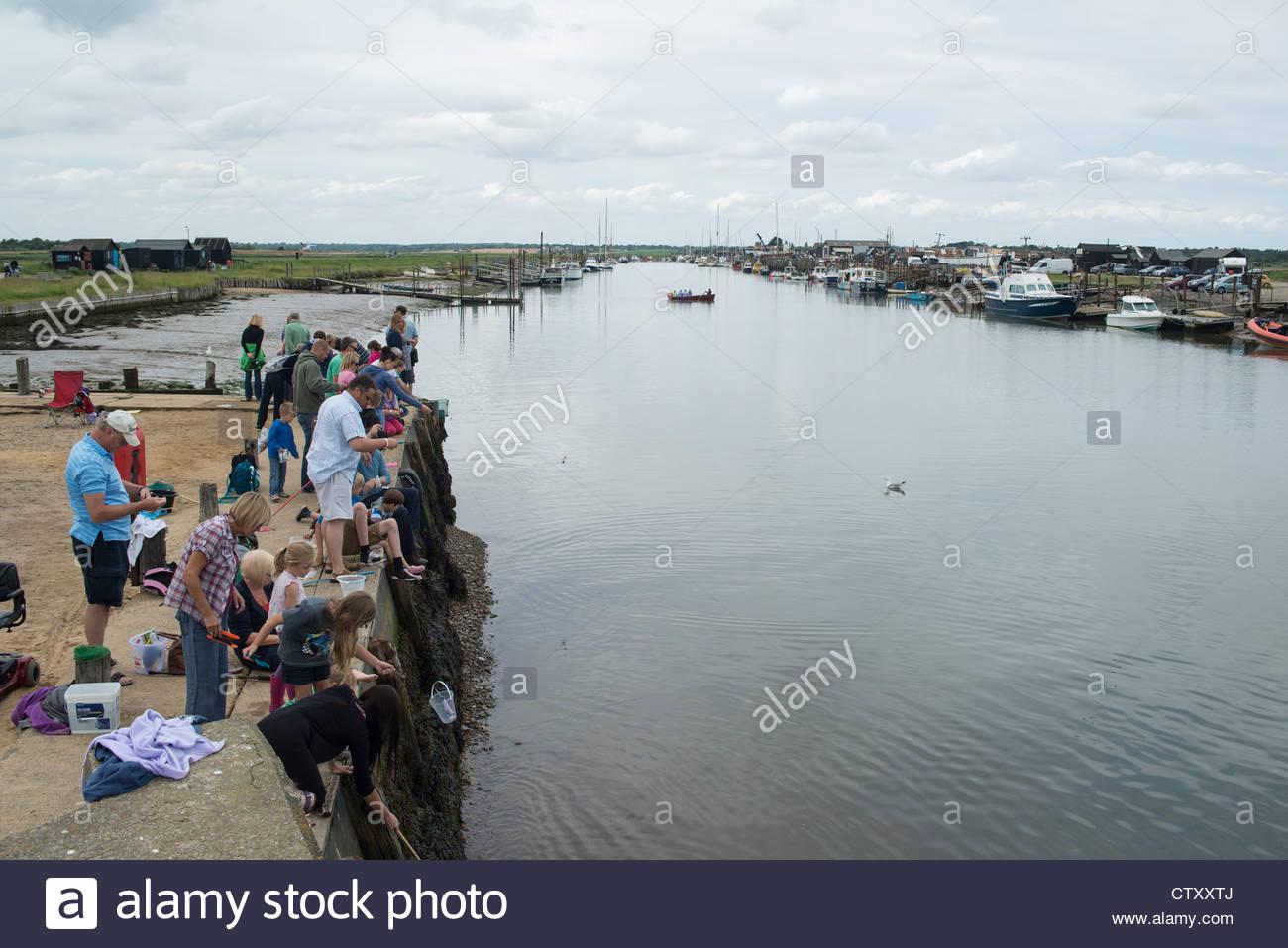 Crabbing at Walberswick - Stock Image