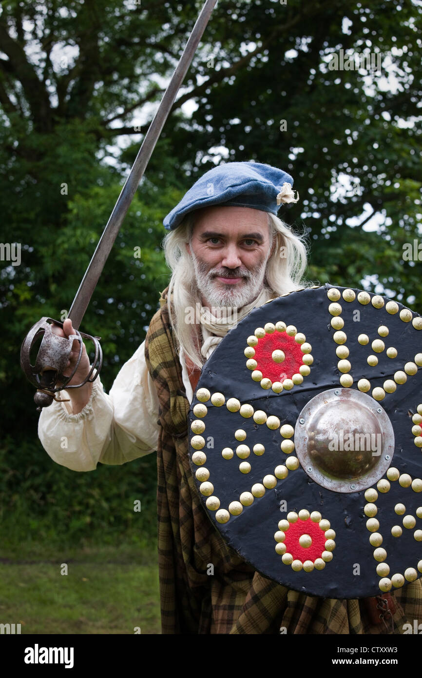 Alex Galbraith, a member of the Beowulf History Club, dressed in the Highland kilt clothing of a Jacobite Highlander. - Stock Image