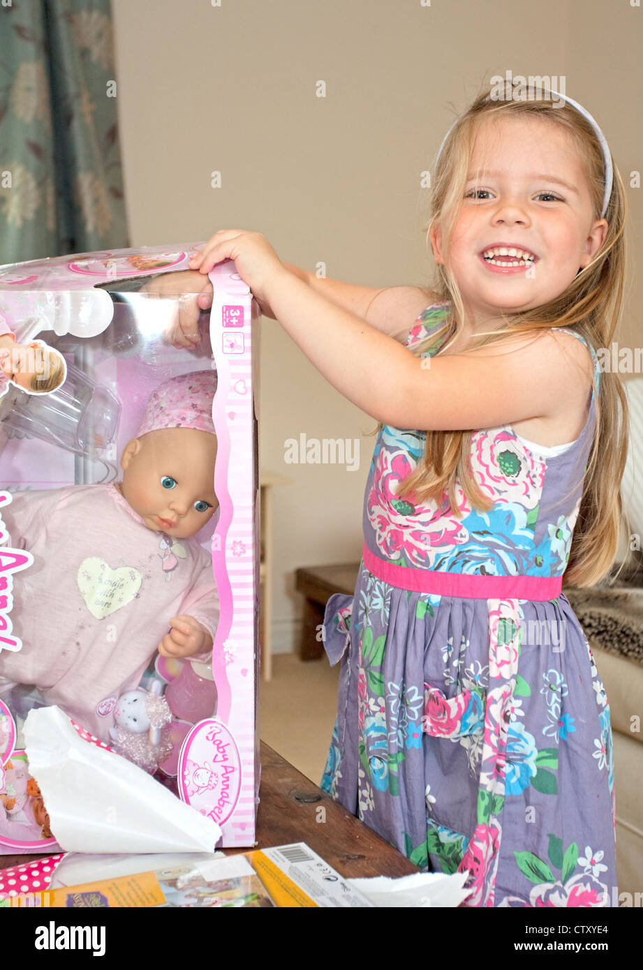 happy child with new toy doll - Stock Image