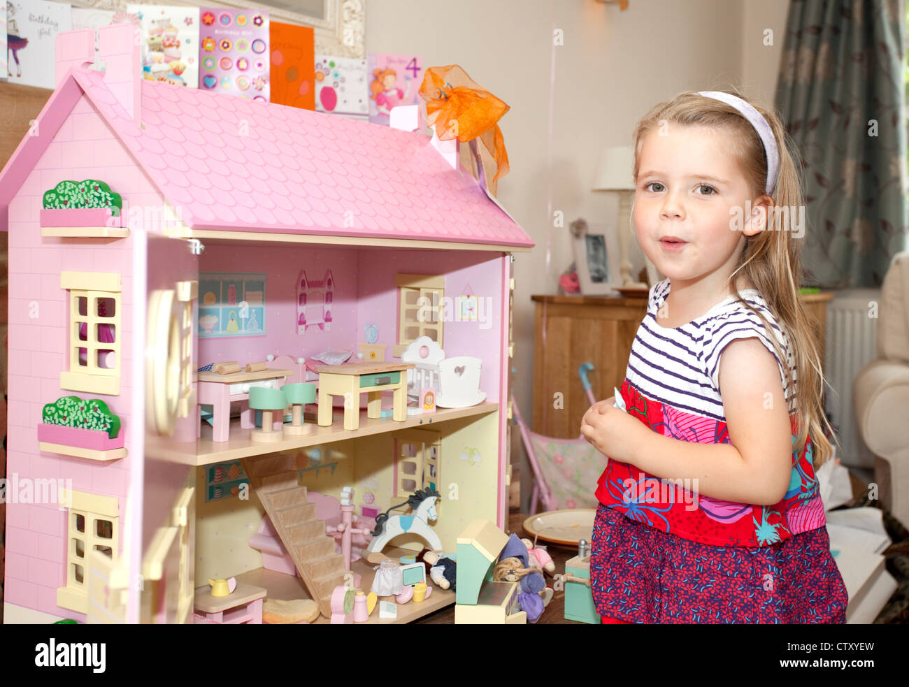 happy child with new dolls house - Stock Image