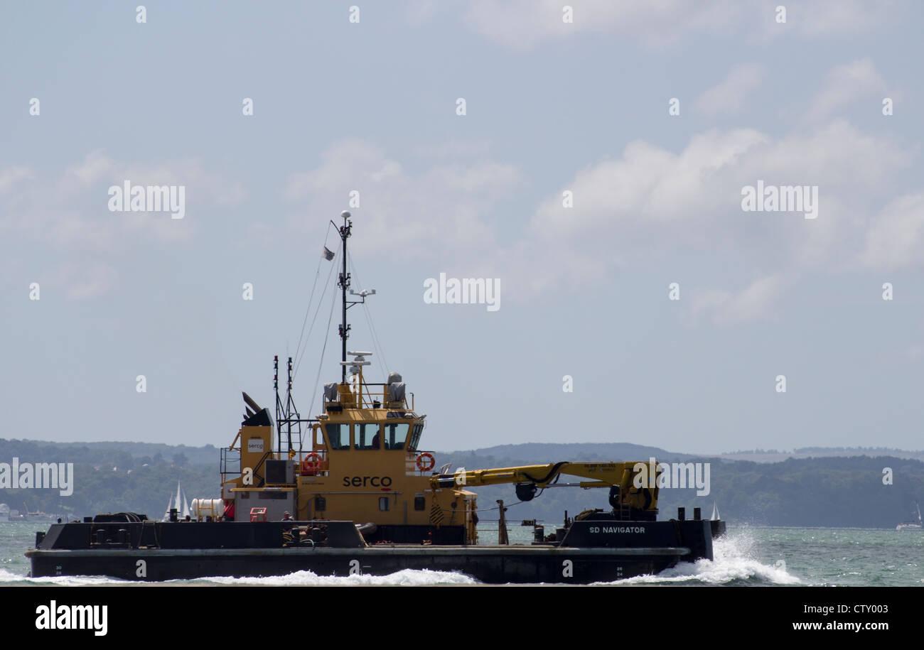 A tugboat off the Southsea shoreline - Stock Image