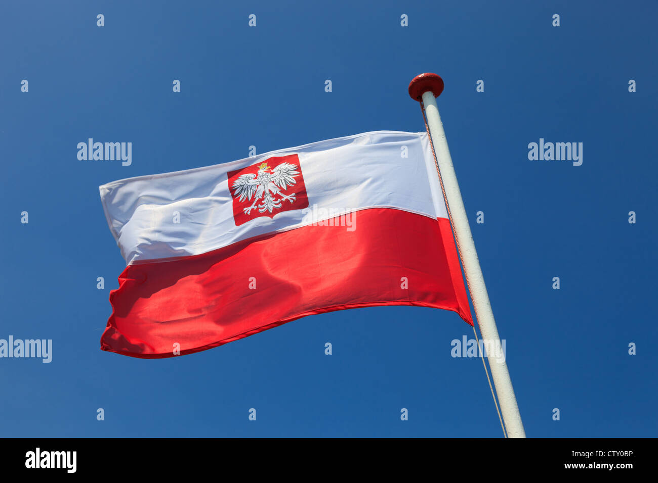 Polish national flag in the sky. - Stock Image