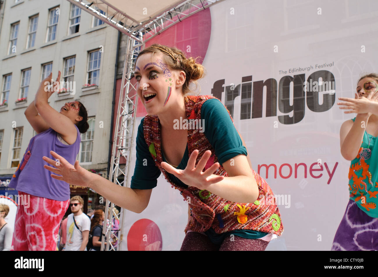 Performers on The Royal Mile promoting their shows for the Edinburgh Festival Fringe. - Stock Image