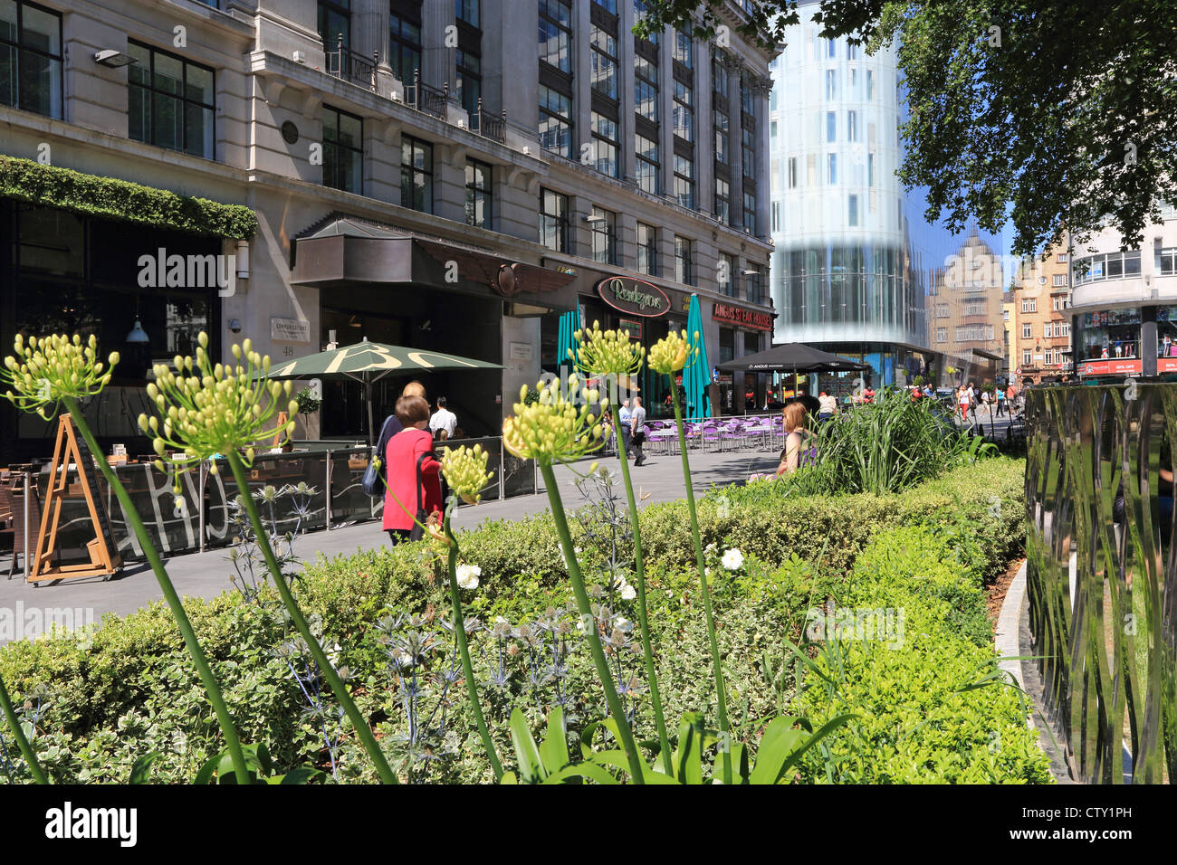The newly renovated (2012) Leicester Square in summer, in the West End of London, England, UK - Stock Image