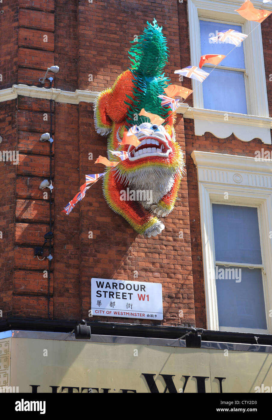 Colourful dragon on Wardour Street in China Town, in London, UK - Stock Image