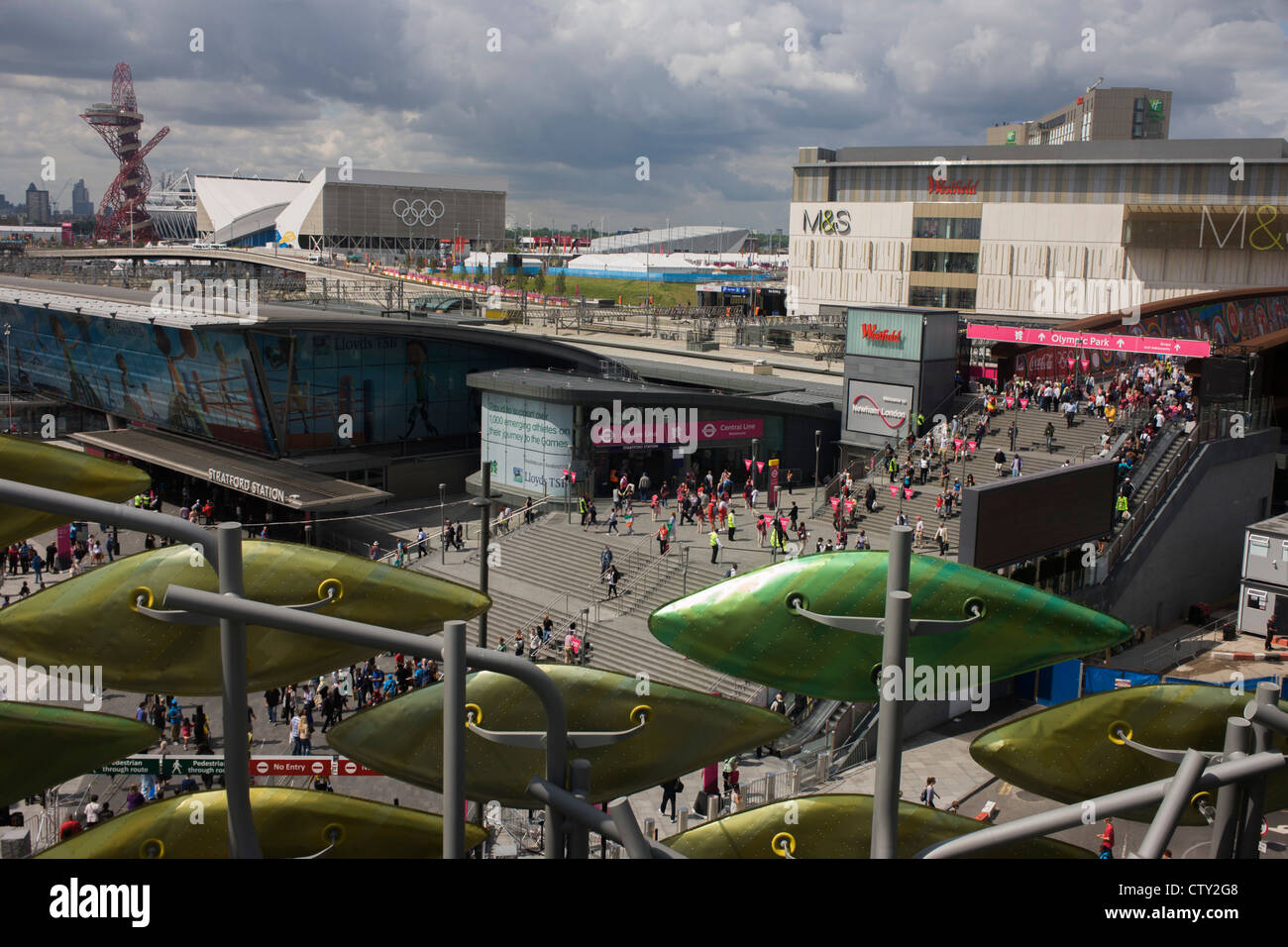 An aerial landscape of Westfield City shopping centre (right), Stratford rail station hub (c) and the Olympic Park - Stock Image