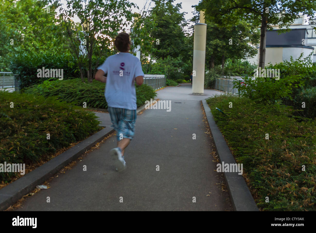 Paris, France,  Man Jogging, Running Away, on Pathway in 'Promenade Plantée' Public park, Alone, adult - Stock Image