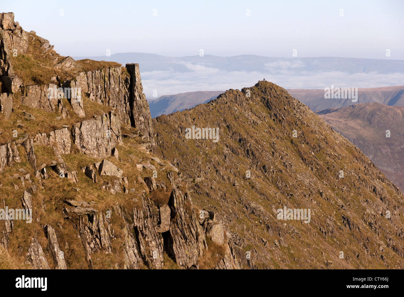 Hill walkers on Striding Edge, Helvellyn, Lake District, Cumbria, England, UK - Stock Image