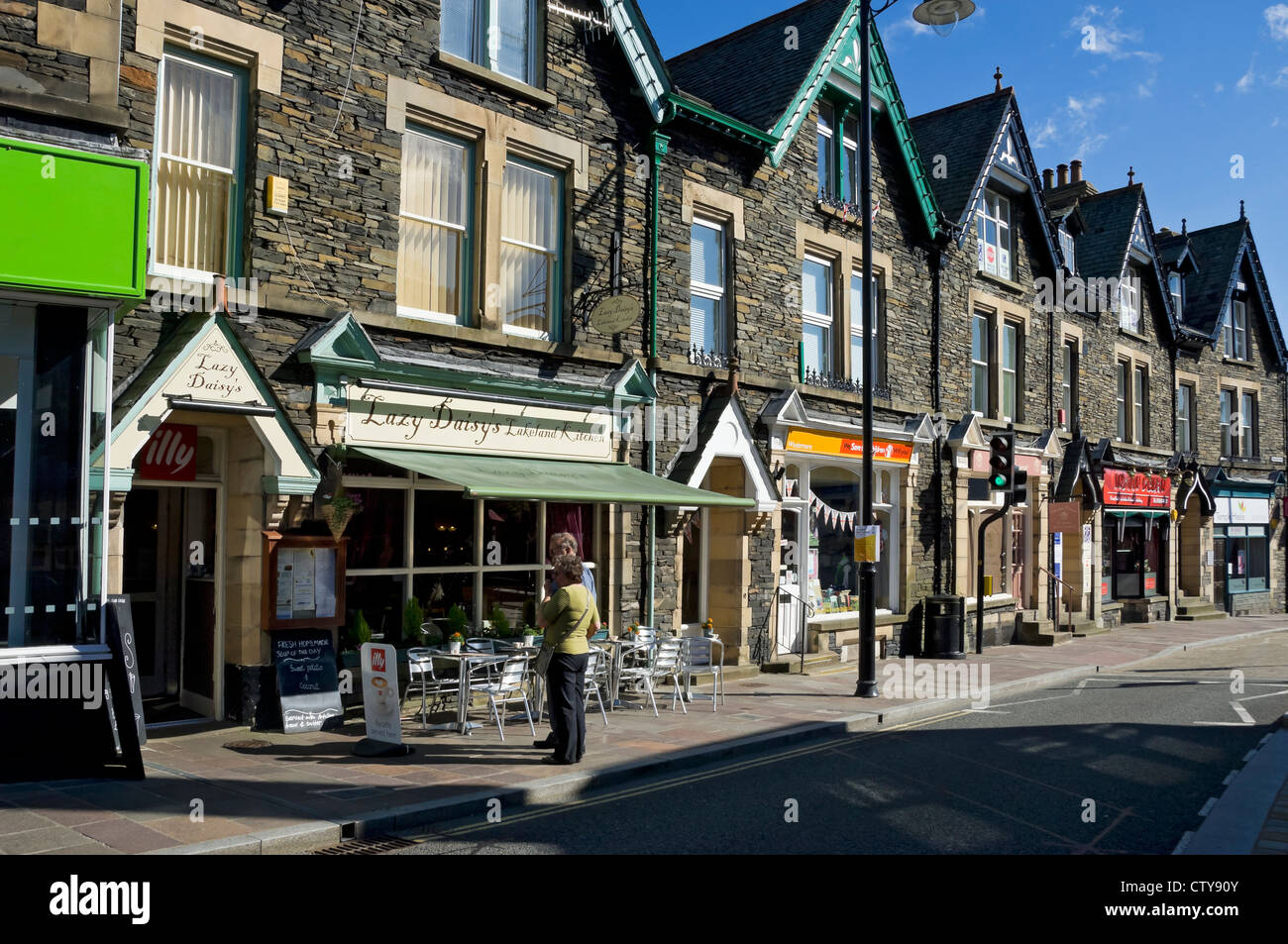 Windermere town centre in summer Cumbria England UK United Kingdom GB Great Britain - Stock Image