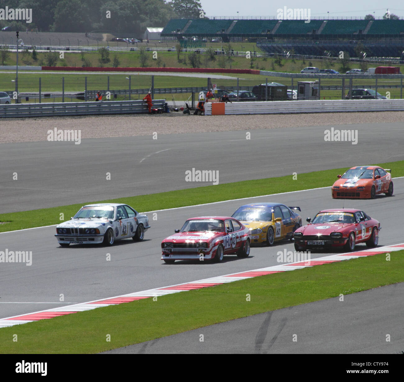 Race at Fujifilm Touring Car Trophy 1970-2000 Silverstone Classic July 22 2012 view from Village Corner - Stock Image
