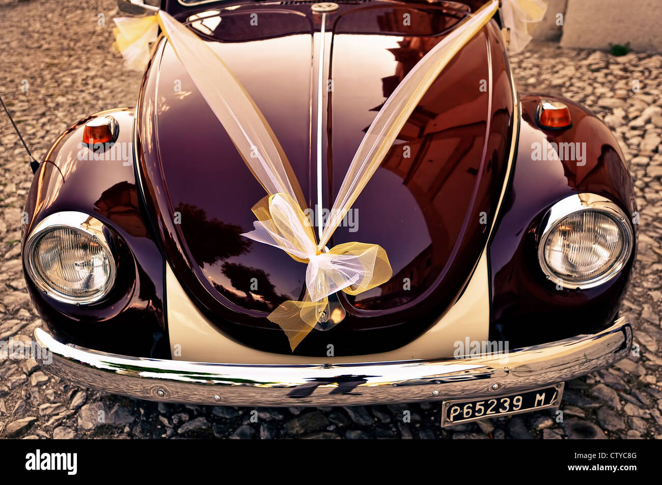 vintage volkswagen beetle with a drape on the bonnet - Stock Image