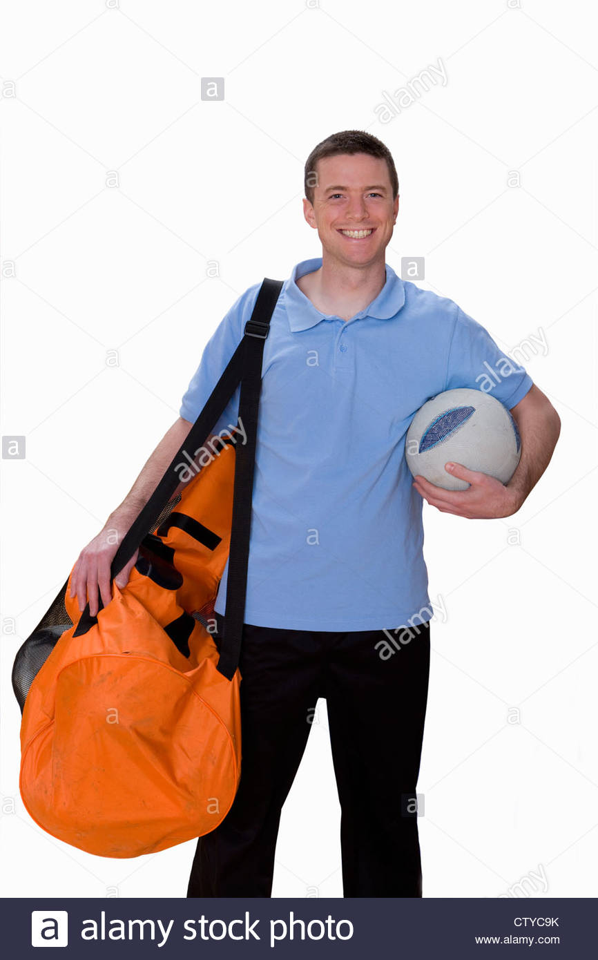9895f70da Cut Out Of Male Soccer Coach With Bag Of Footballs - Stock Image