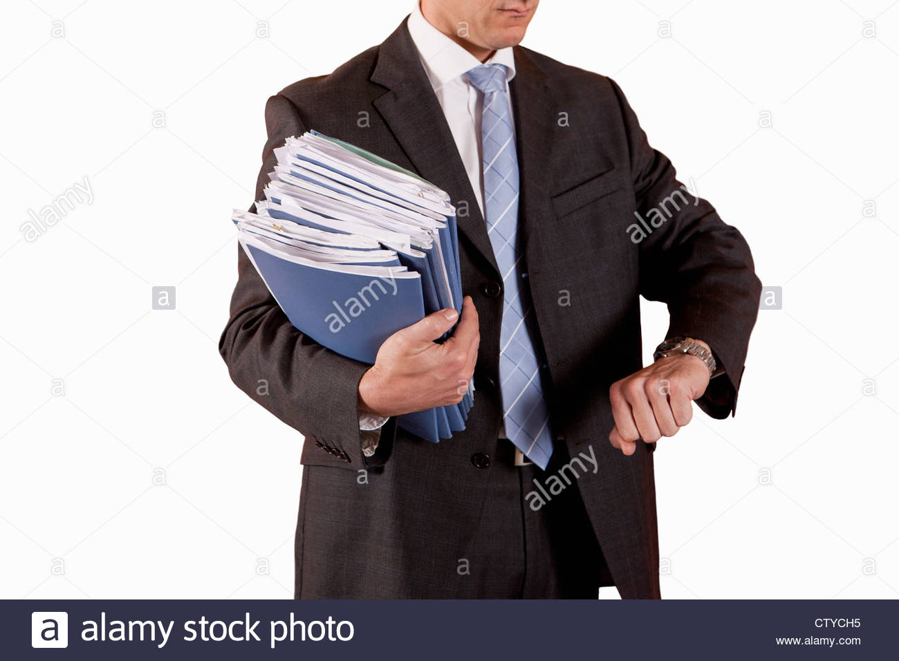 Cut Out Of Middle Aged Male Executive Holding Documents And Checking Watch - Stock Image