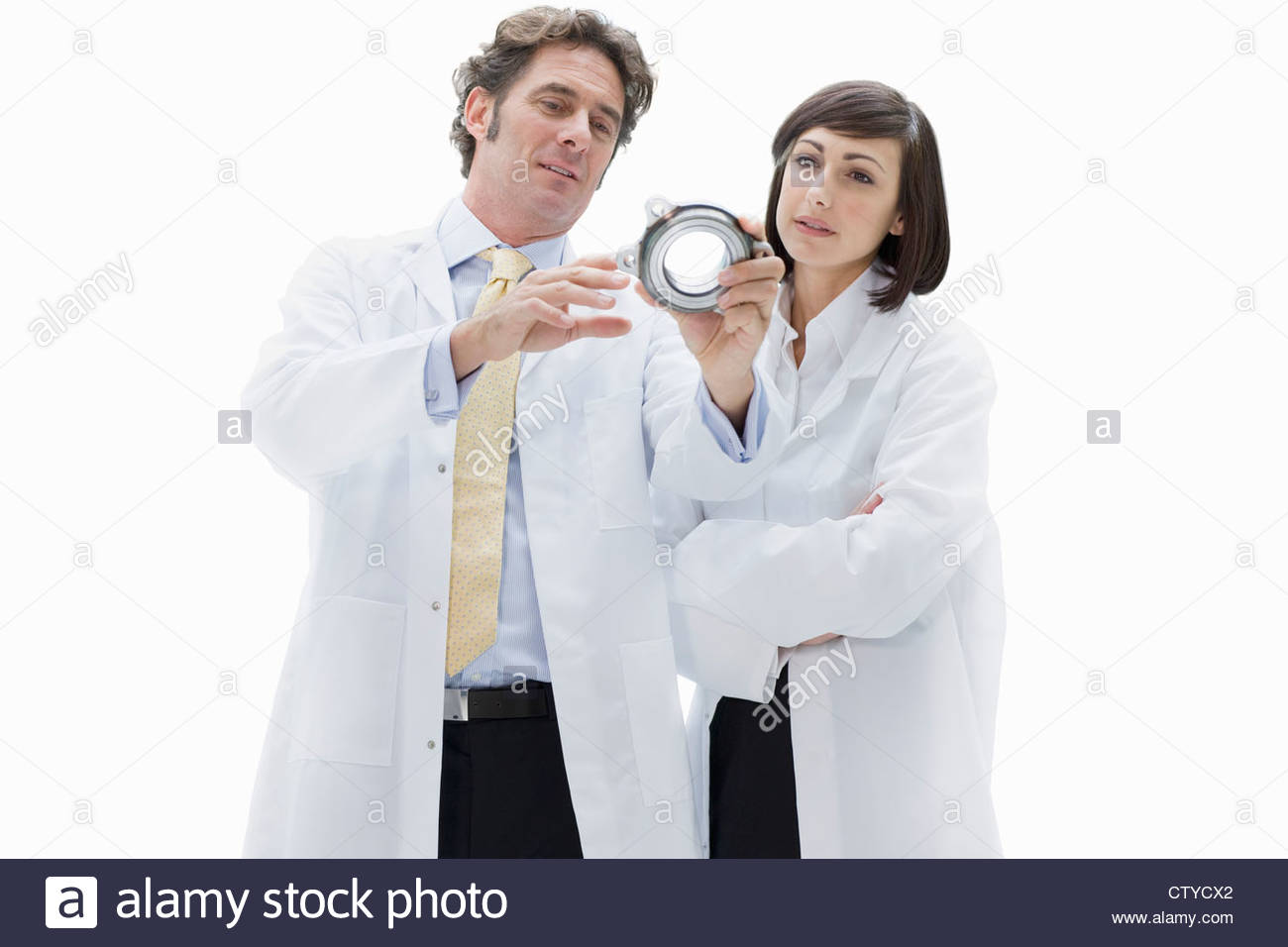 Cut Out Of Male And Female Engineers Discussing Component - Stock Image