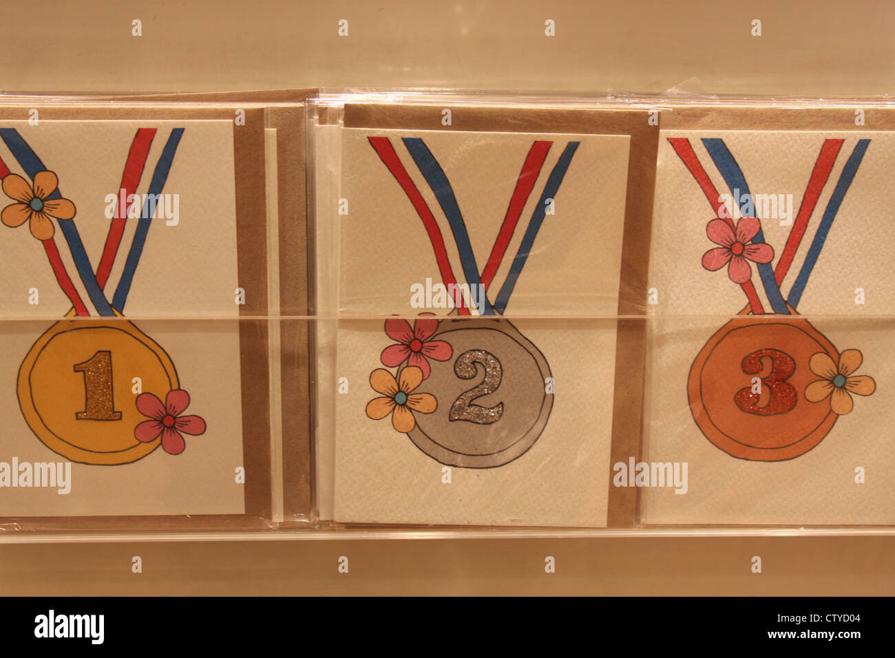 Gold silver and bronze medal greeting cards - Stock Image