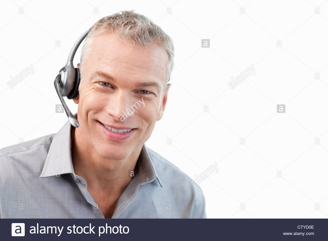 male worker wears headphones - 1000×668