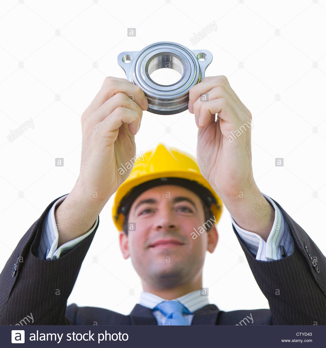 Cut Out Of Male Engineer Holding Component - Stock Image