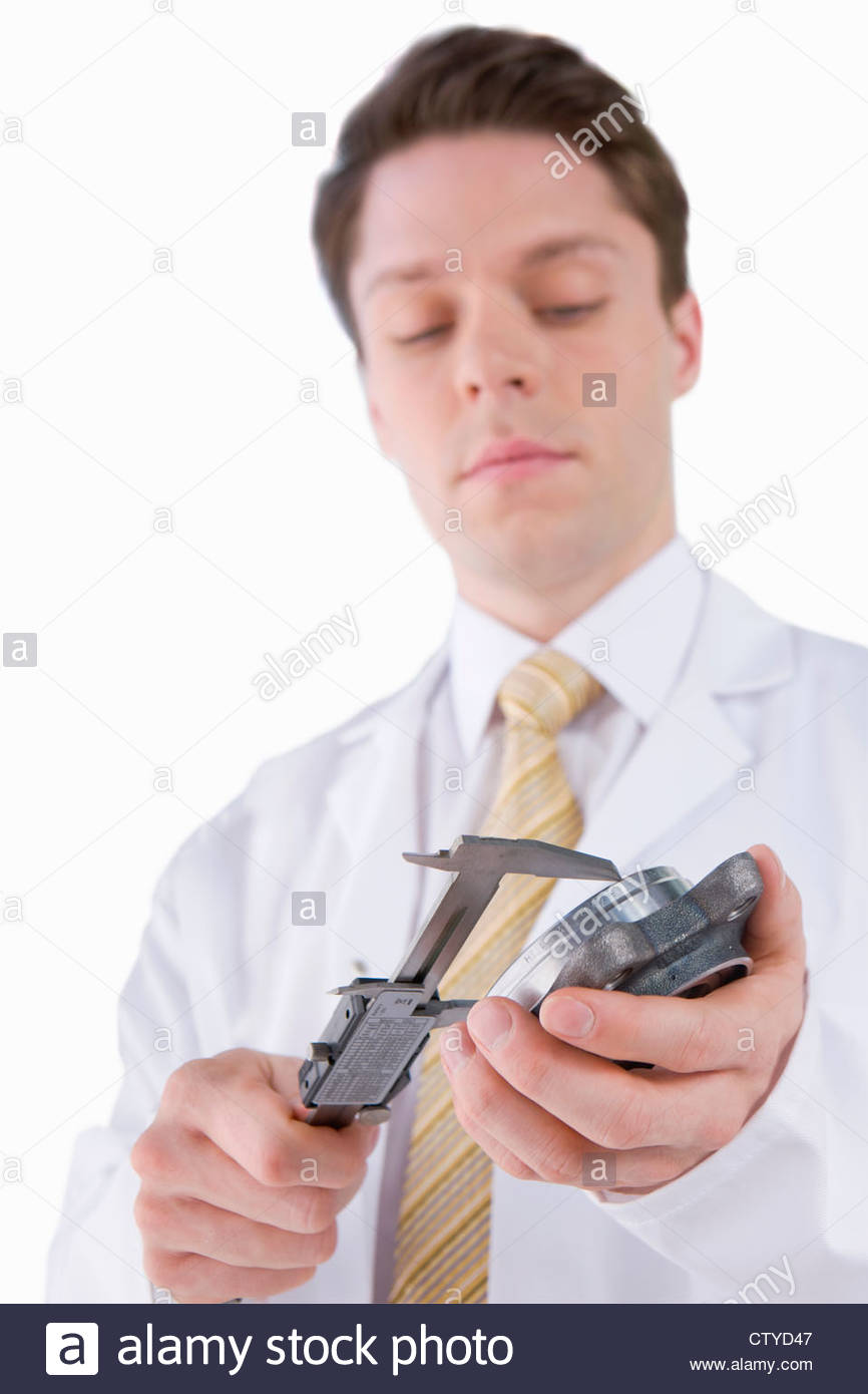 Cut Out Of Male Engineer Measuring Component - Stock Image