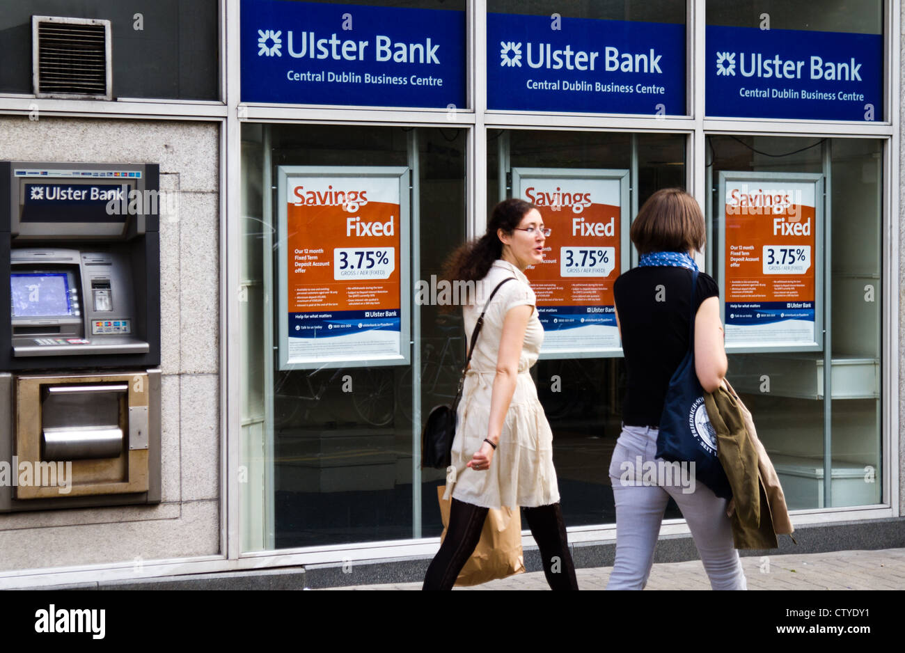 Two women walk past Ulster Bank in Dublin Ireland - Stock Image