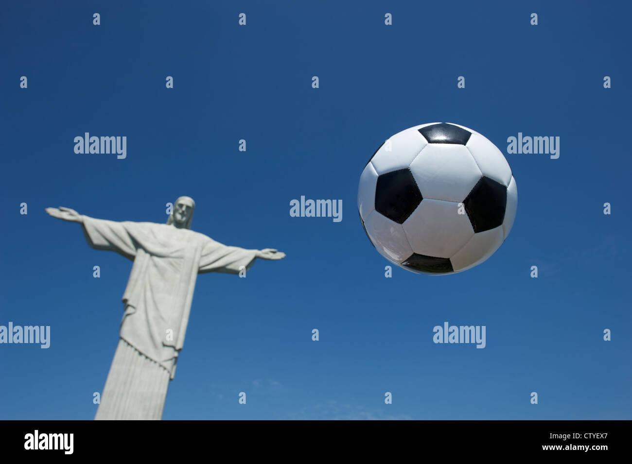 Soccer Ball Football Floats in the Sky at Corcovado Rio de Janeiro - Stock Image