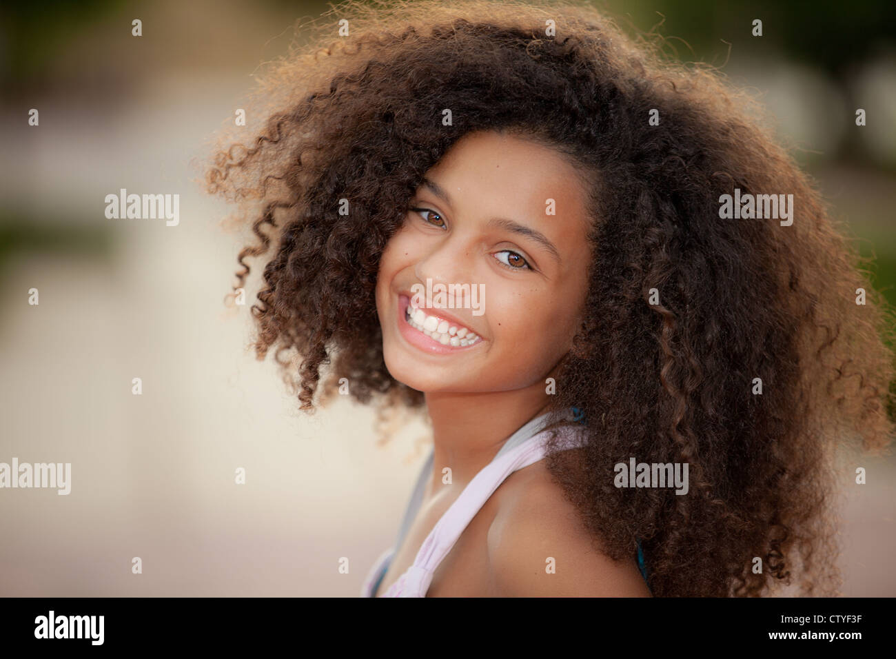 happy smiling african descent child with afro hair style - Stock Image