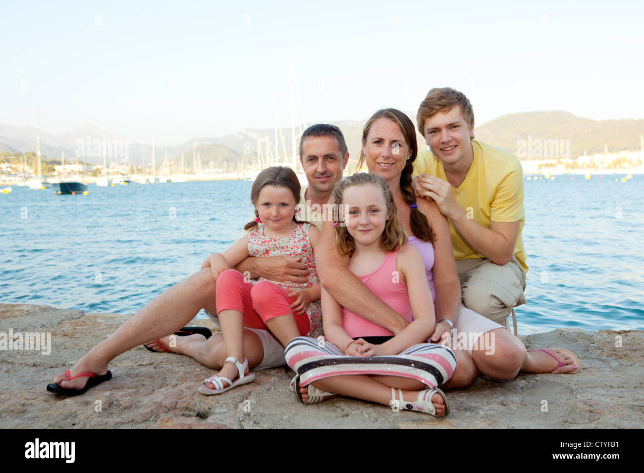 happy family on summer vacation or holiday - Stock Image