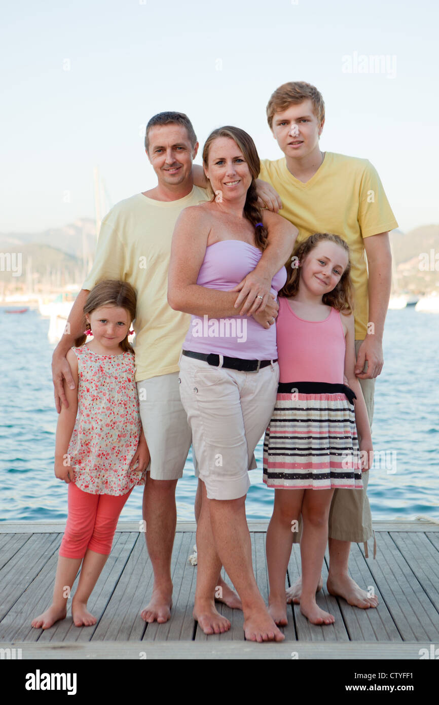 happy smiling summer holiday or vacation family group - Stock Image