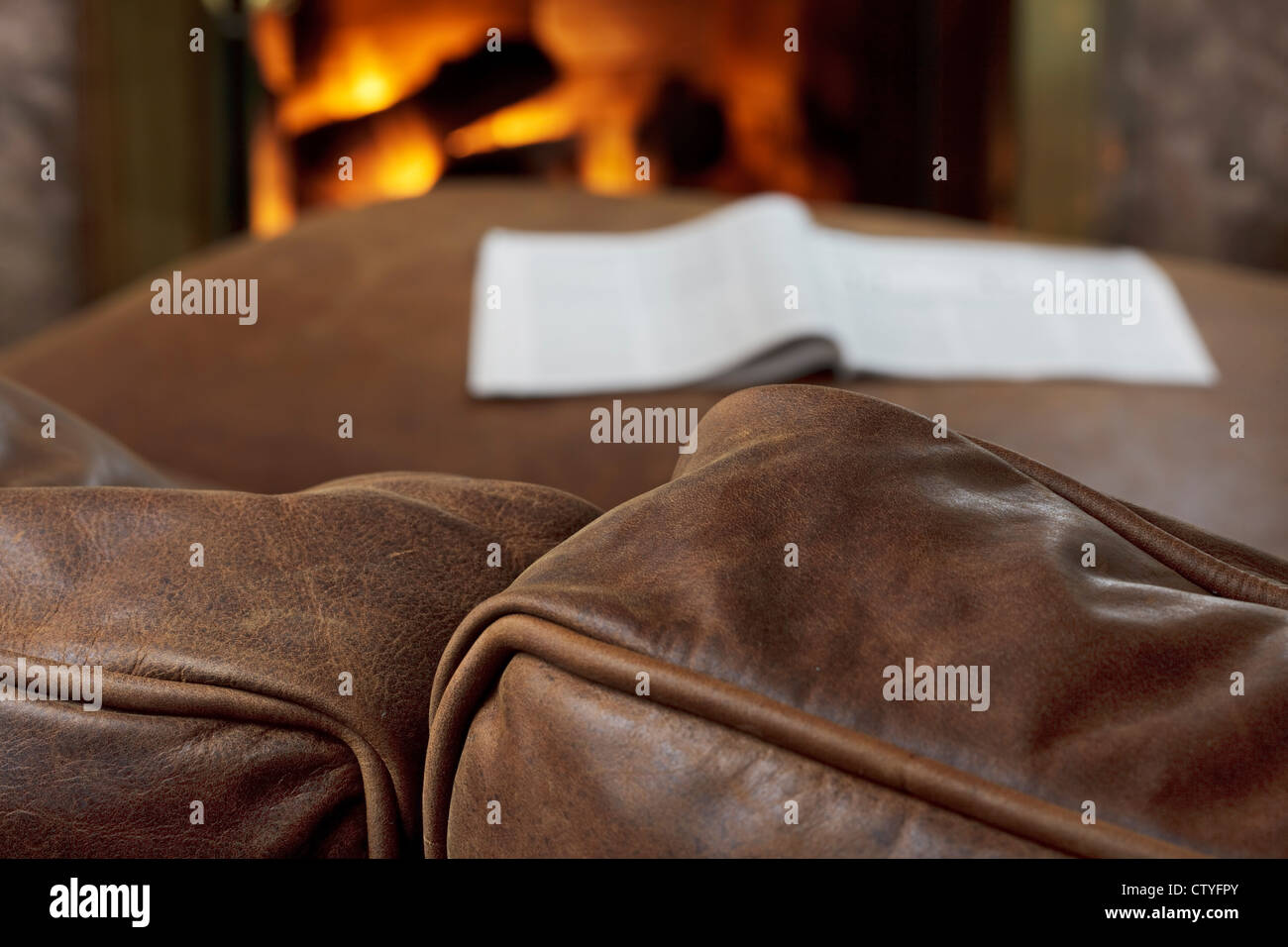 Brilliant Soft Brown Leather Sofa By A Warm Fire Stock Photo 49777587 Squirreltailoven Fun Painted Chair Ideas Images Squirreltailovenorg