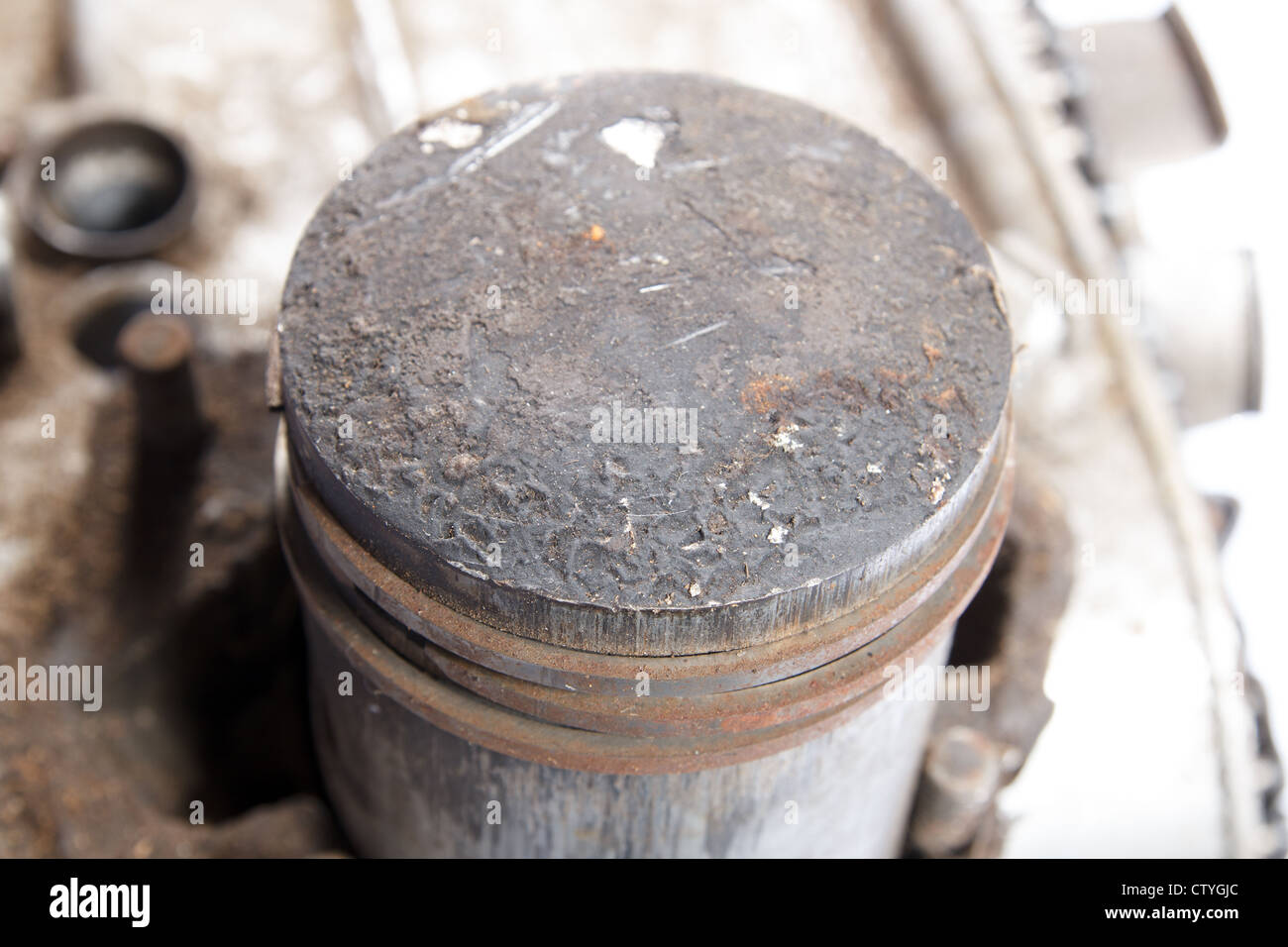 close up of old dirty engine piston - Stock Image