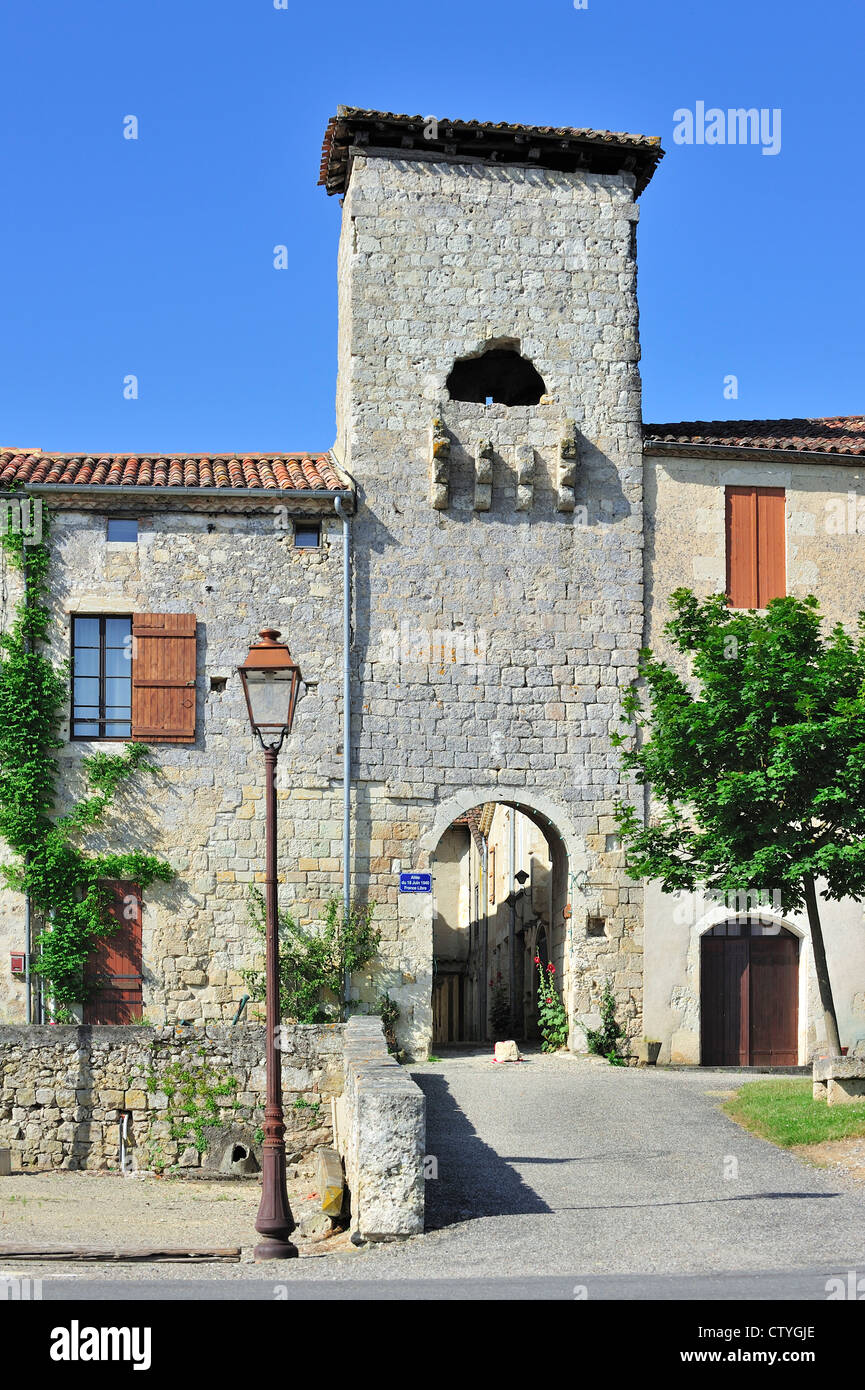 Medieval town gate at La Romieu, Gers, Pyrenees, France - Stock Image