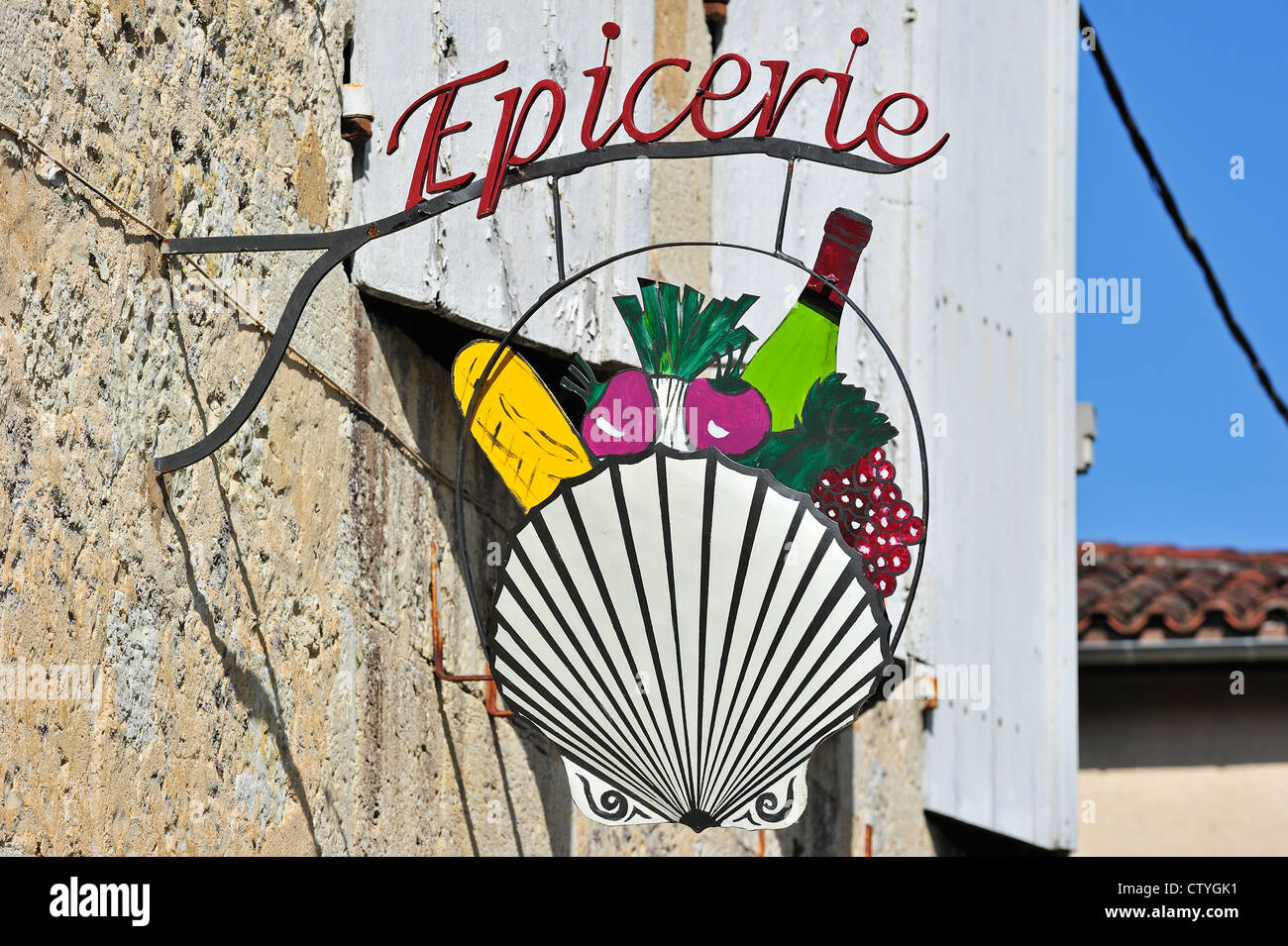 Signboard at grocery shop showing scallop symbol along the road to Santiago de Compostela at La Romieu, Pyrenees, - Stock Image