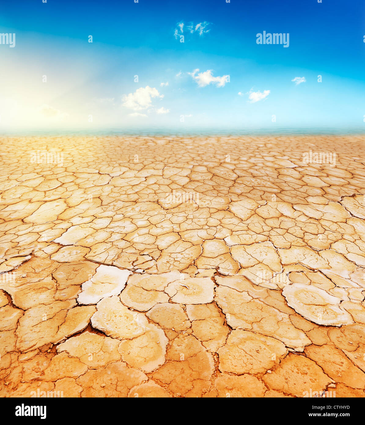 Dry, parched, cracked earth - Stock Image