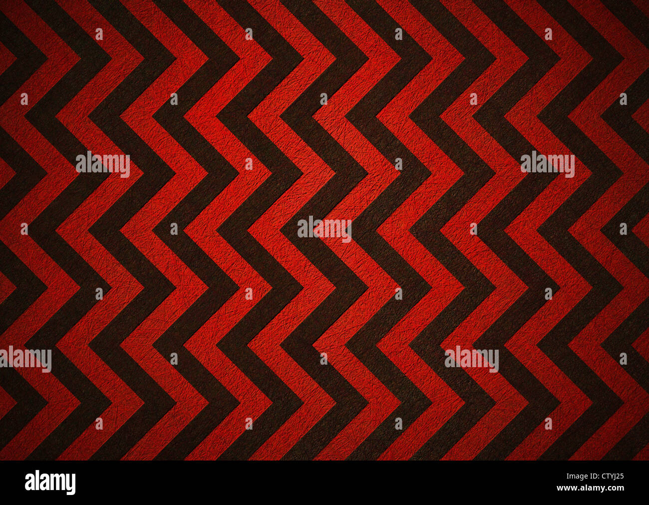 black and red retro background of chevron stripe pattern - Stock Image