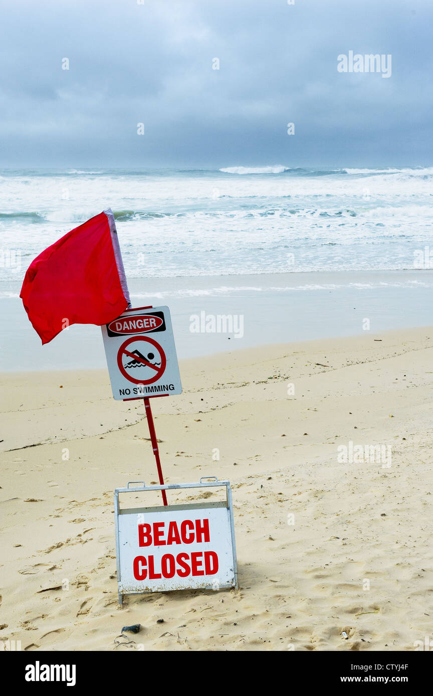 A red warning flag on Coolum Beach in Queensland, Australia. - Stock Image