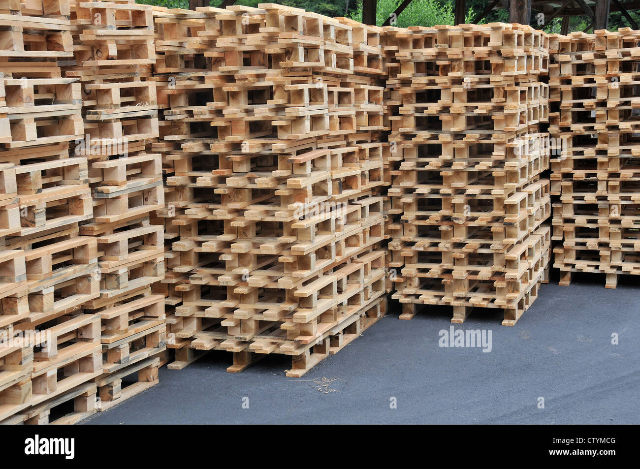 stacks of wooden pallets ready to be used to transport goods Puy de Dome Auvergne Massif Central France - Stock Image