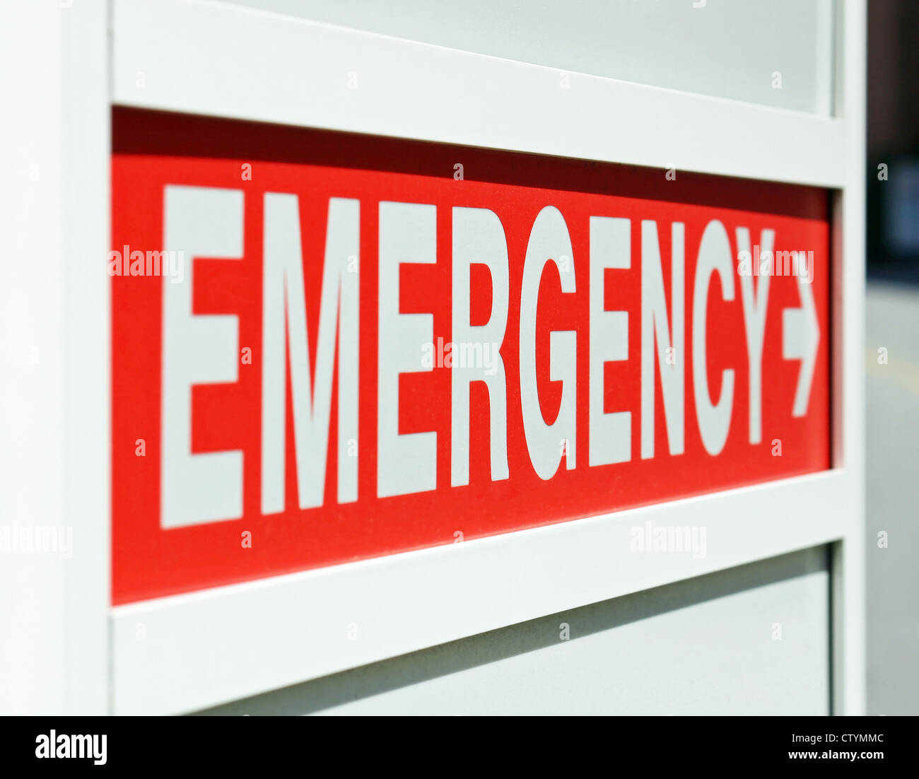 A red Emergency sign at the entrance to a hospital - Stock Image