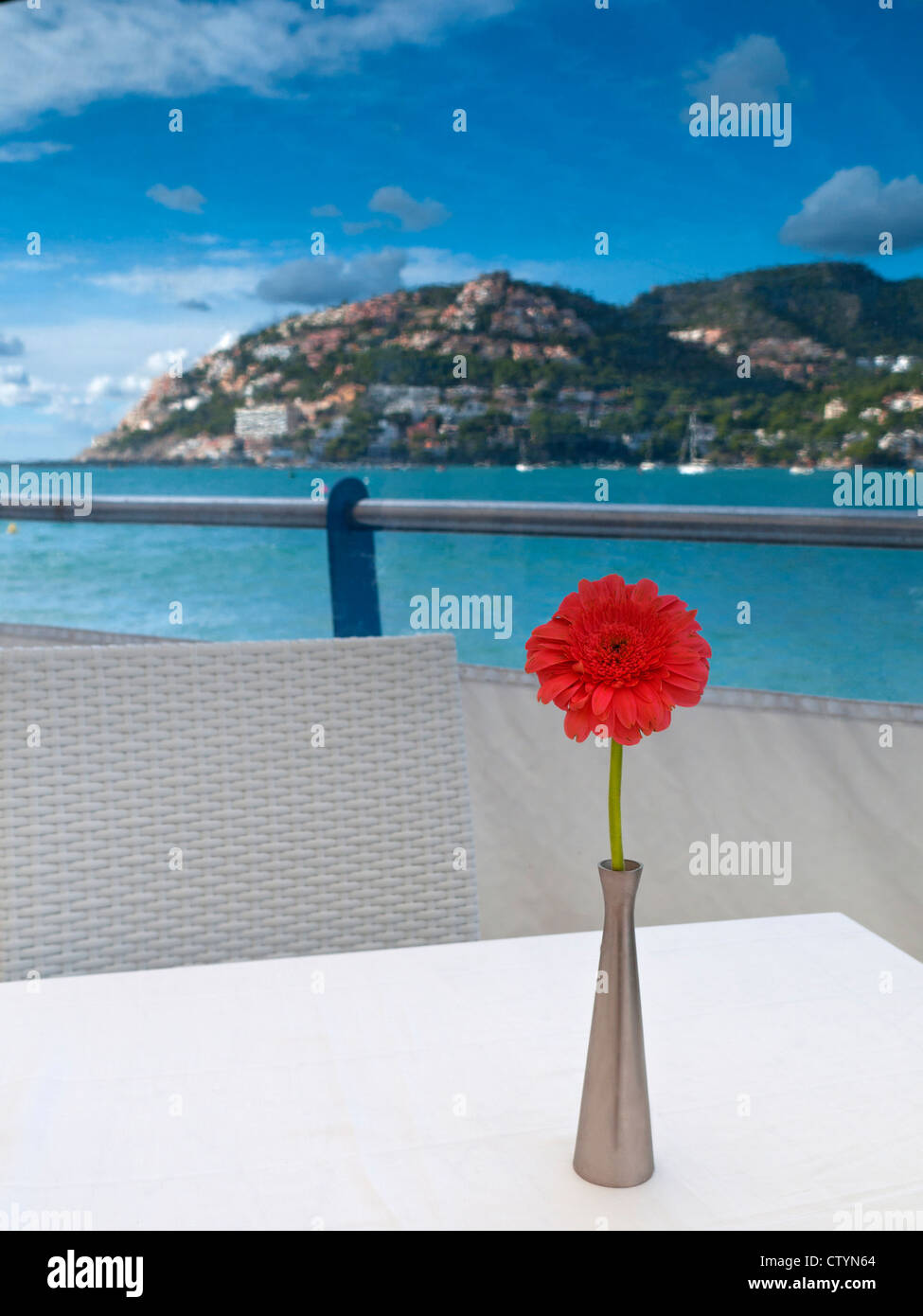 Alfresco holiday restaurant table with sea view in Puerto Andratx Mallorca Balearic Islands Spain - Stock Image