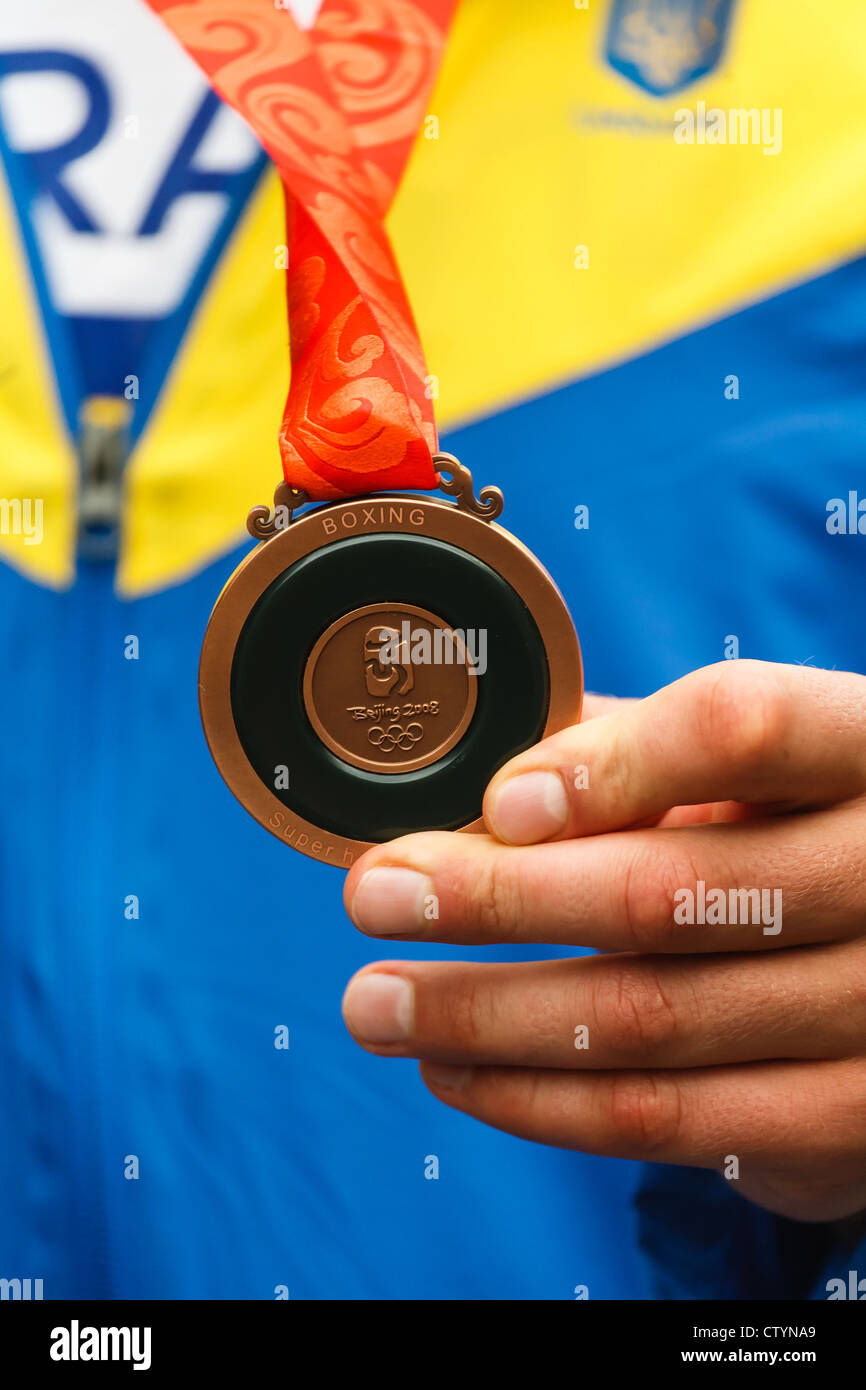 Vyacheslav Glazkov of Ukraine shows his bronze medal from super heavyweight boxing division at the 2008 Olympic - Stock Image