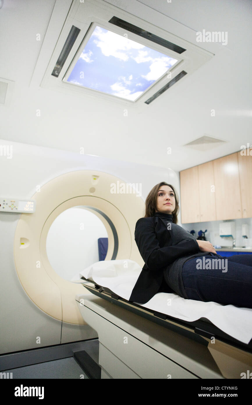 Young female patient  in radiology department - Stock Image