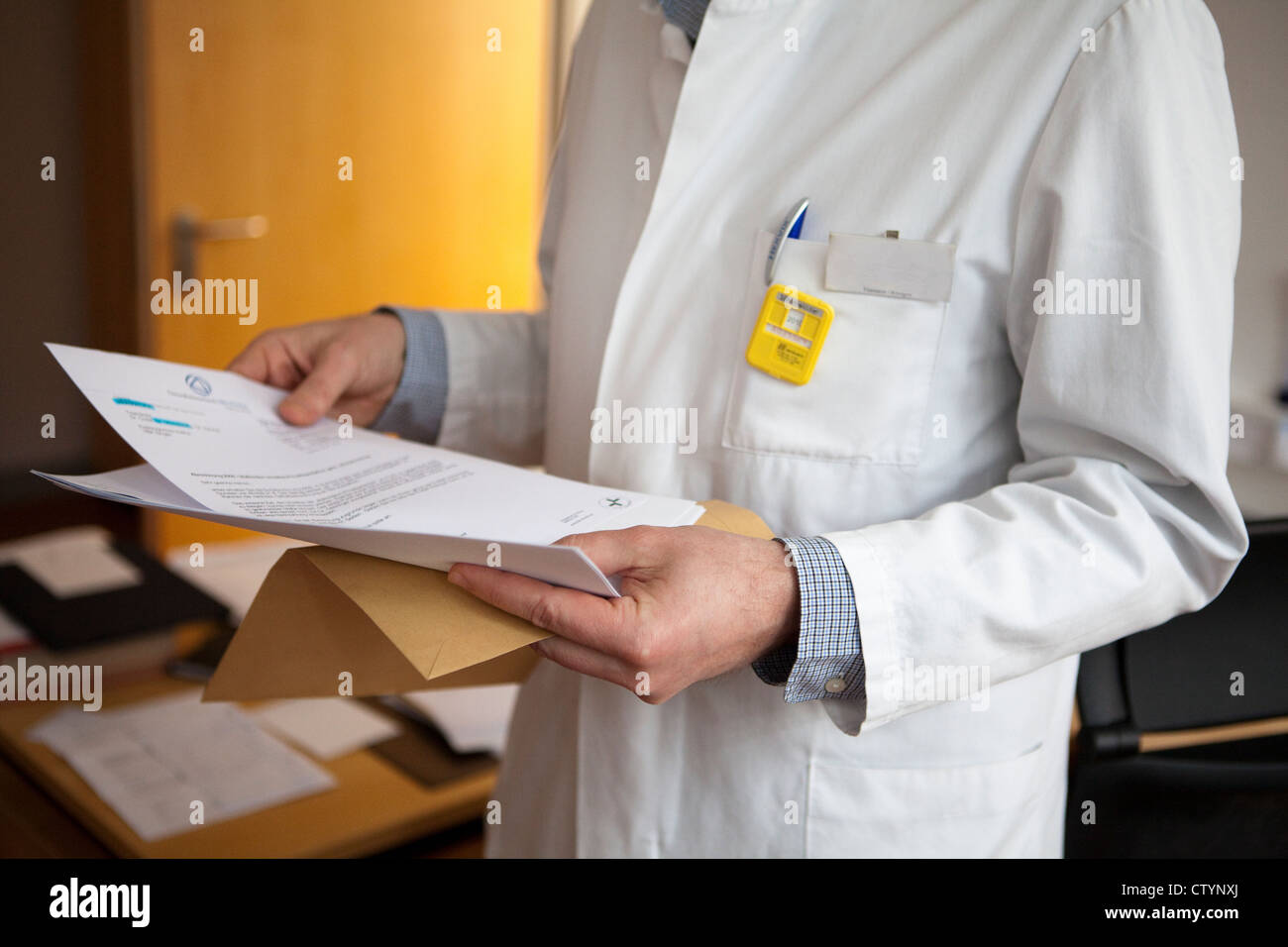 Close-up of radiologist wearing dosimeter badge in a hospital - Stock Image