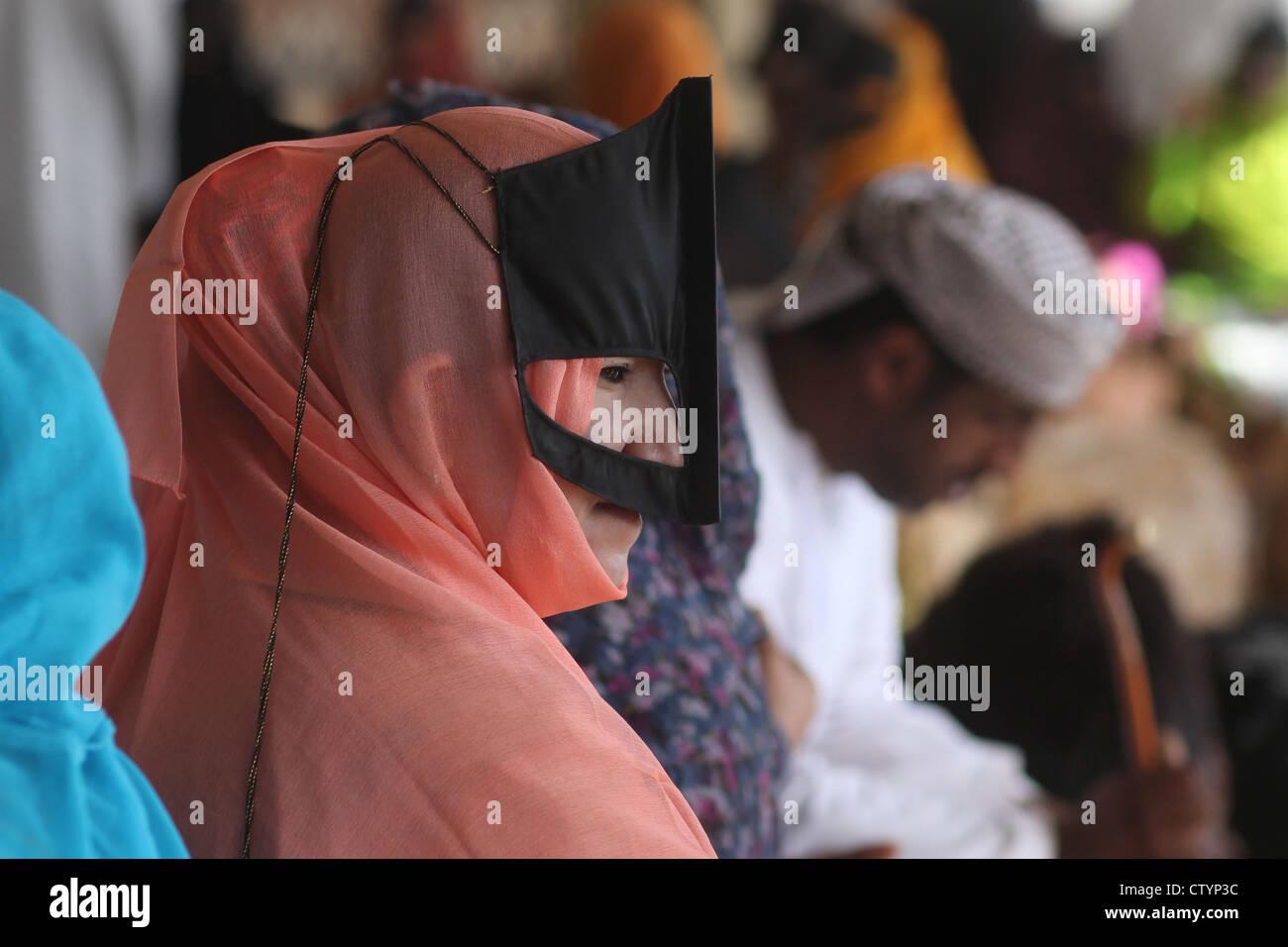 Muslim woman wearing mask and niqaab - Stock Image