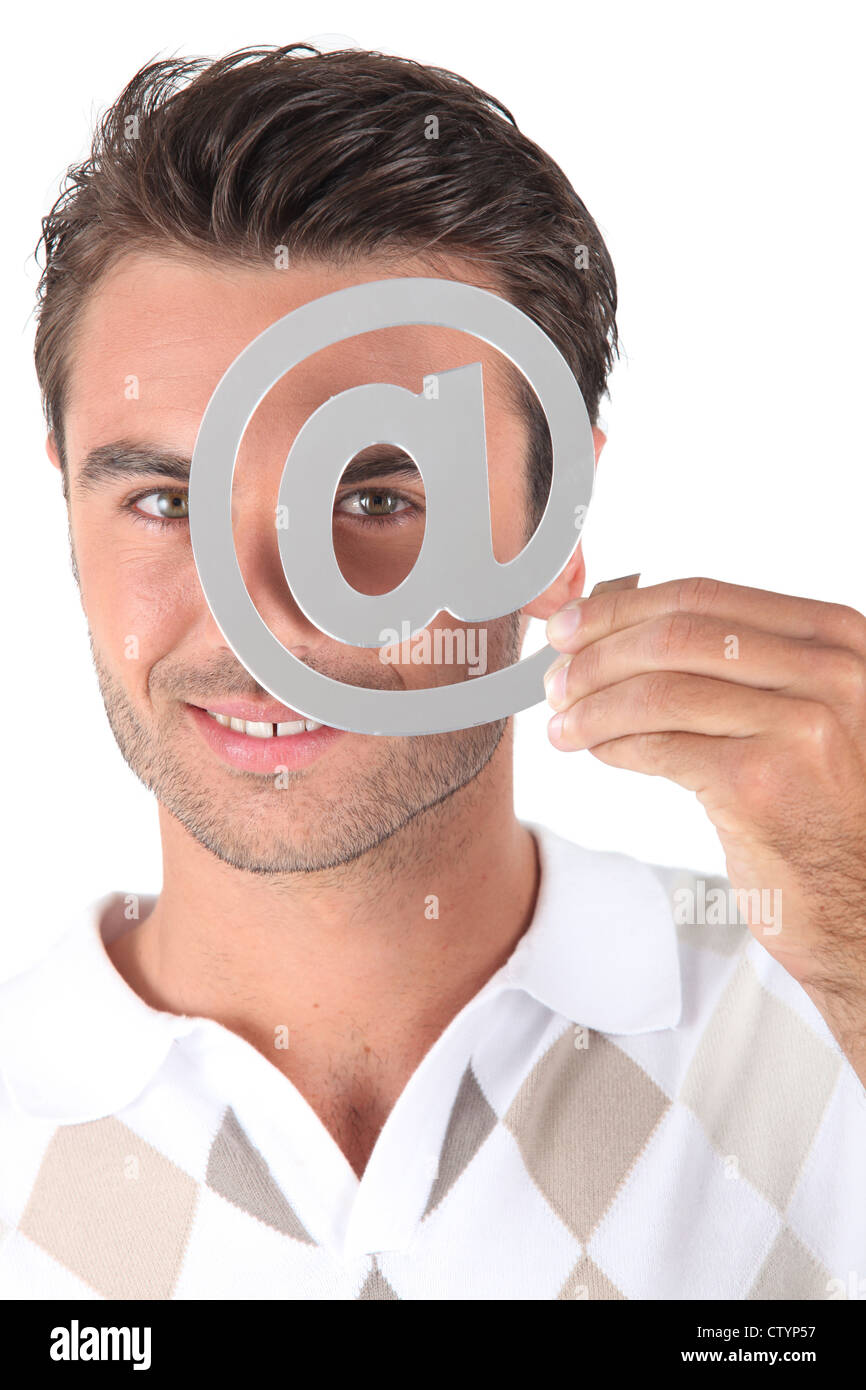 Covering eye with at symbol - Stock Image