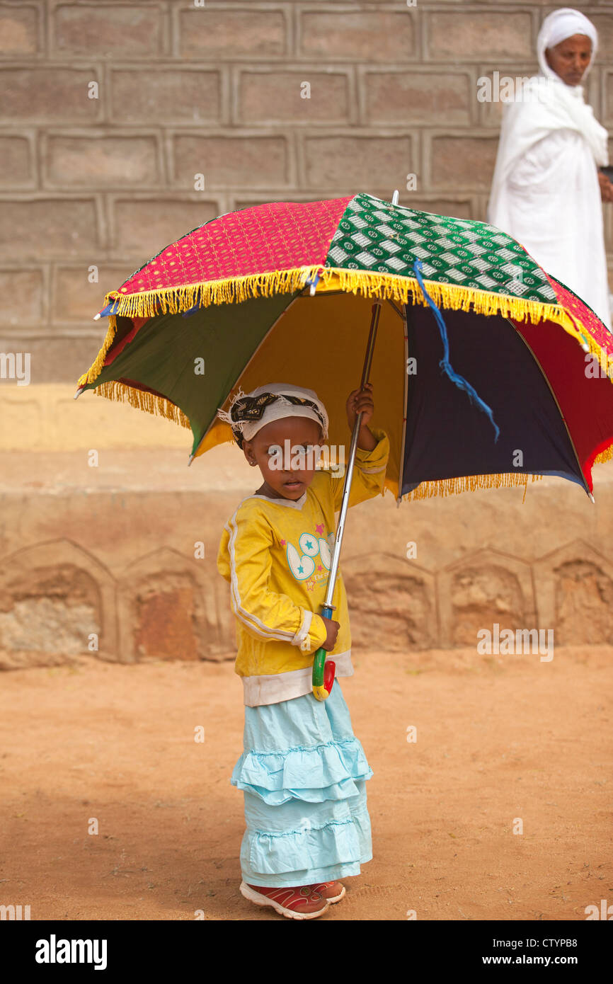 Young African girl with umbrella Stock Photo