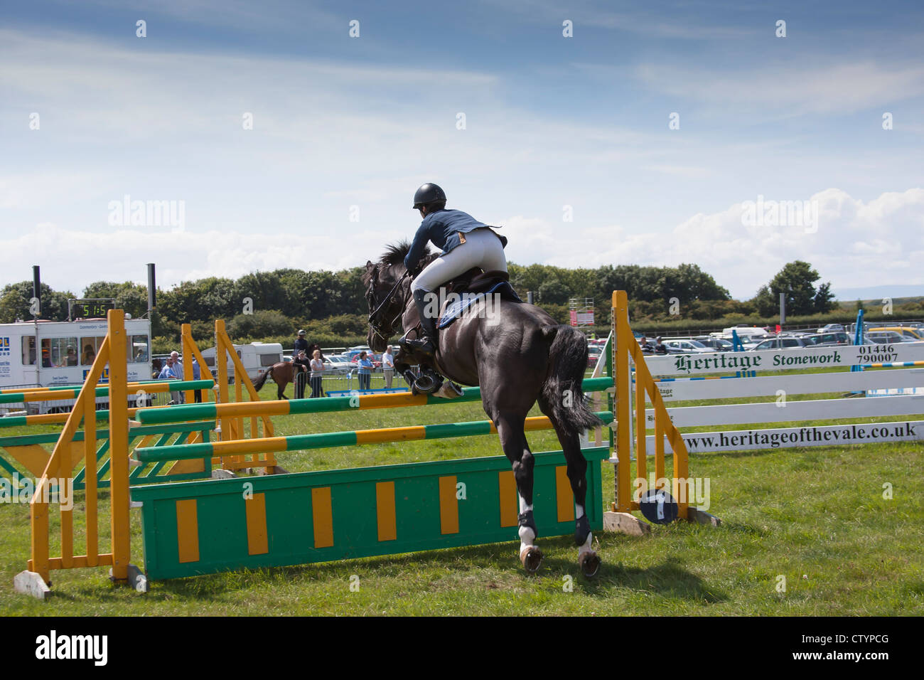 Show jumping lady rider rear view - Stock Image
